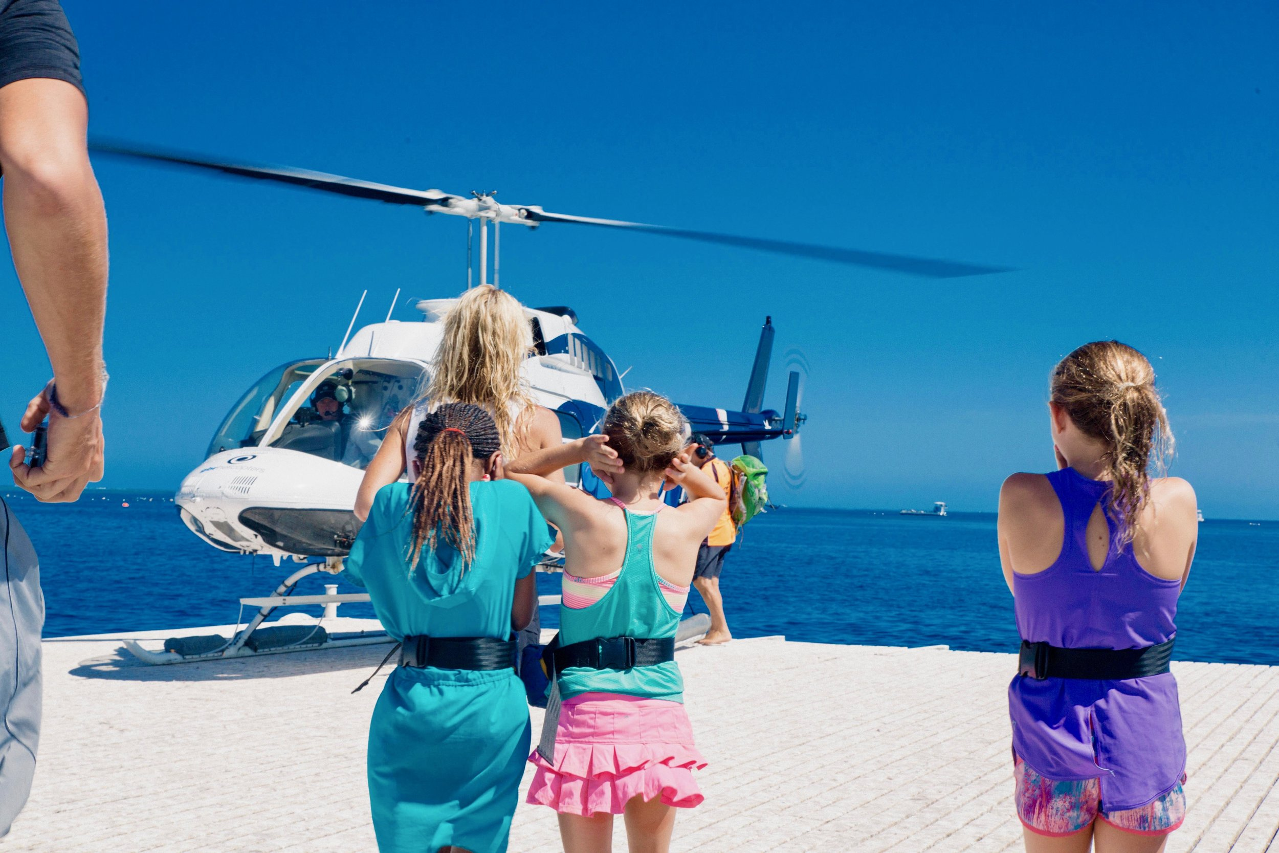 Now boarding......... 30 minute helicopter ride over the Great Barrier Reef in Australia. The 2,300km long eco-system is the world's largest living single structure, and can be seen from outer space. A UNESCO World Heritage site, this reef is home to countless species of colorful fish, turtles, dolphins and sharks.