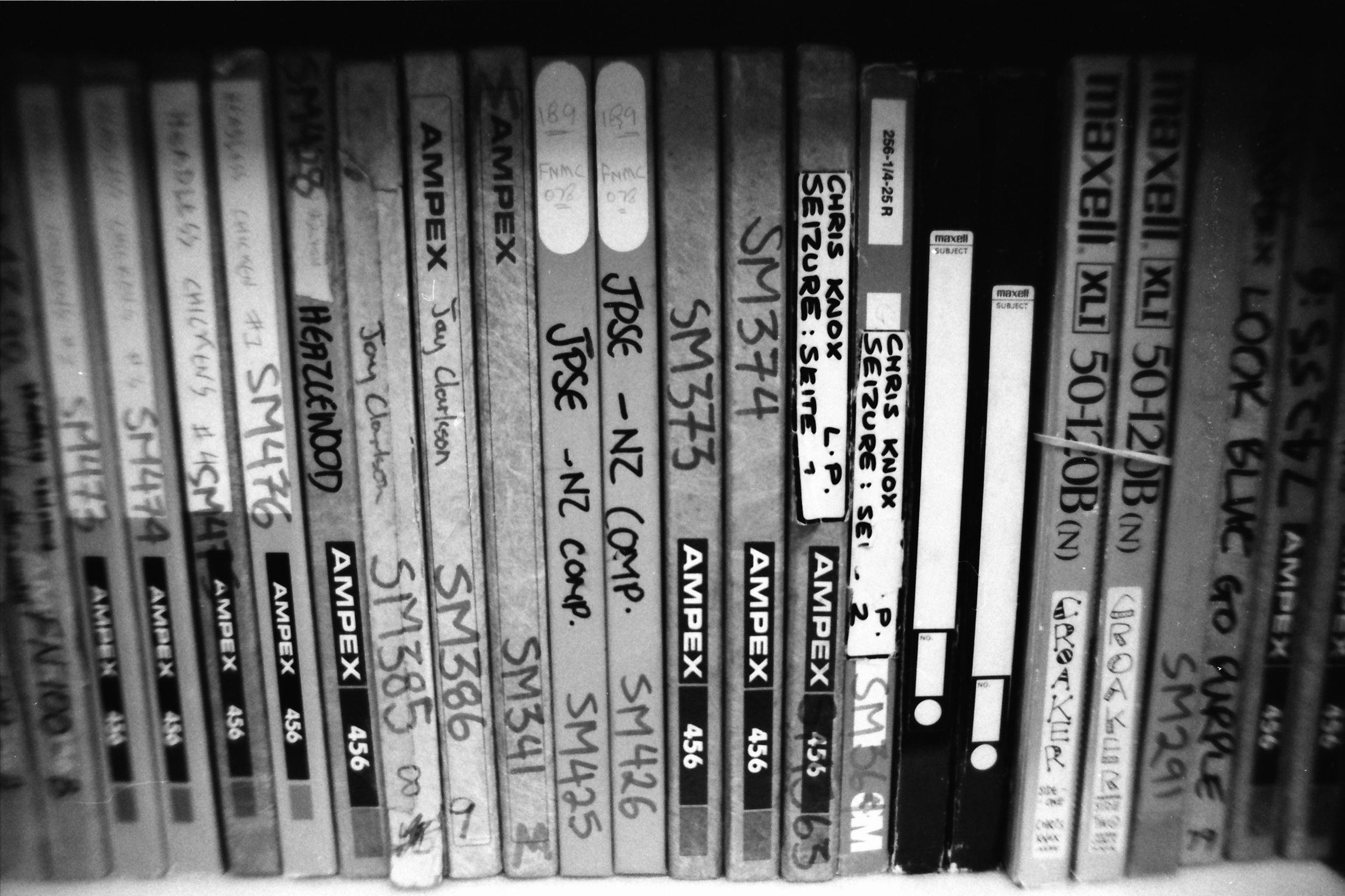 Some of the Flying Nun master tapes - photo taken with b&w Illford Delta 35mm film, Nikon FE2 Nikkor 24mm f2