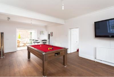 The brochure pic. TV. Pool table. Bar. Joe's ideal room. Wishful thinking, love.