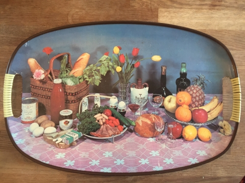 Because everyone needs a tray with broccoli, carnations, sausages and a packet of fags on it.