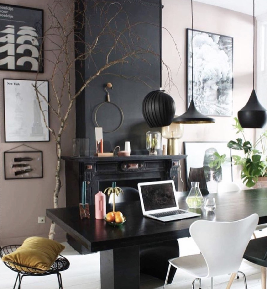 Theobert Pot  has combined pink walls with dark grey to great effect and the natural textures that he has used only serve to perfect the space.