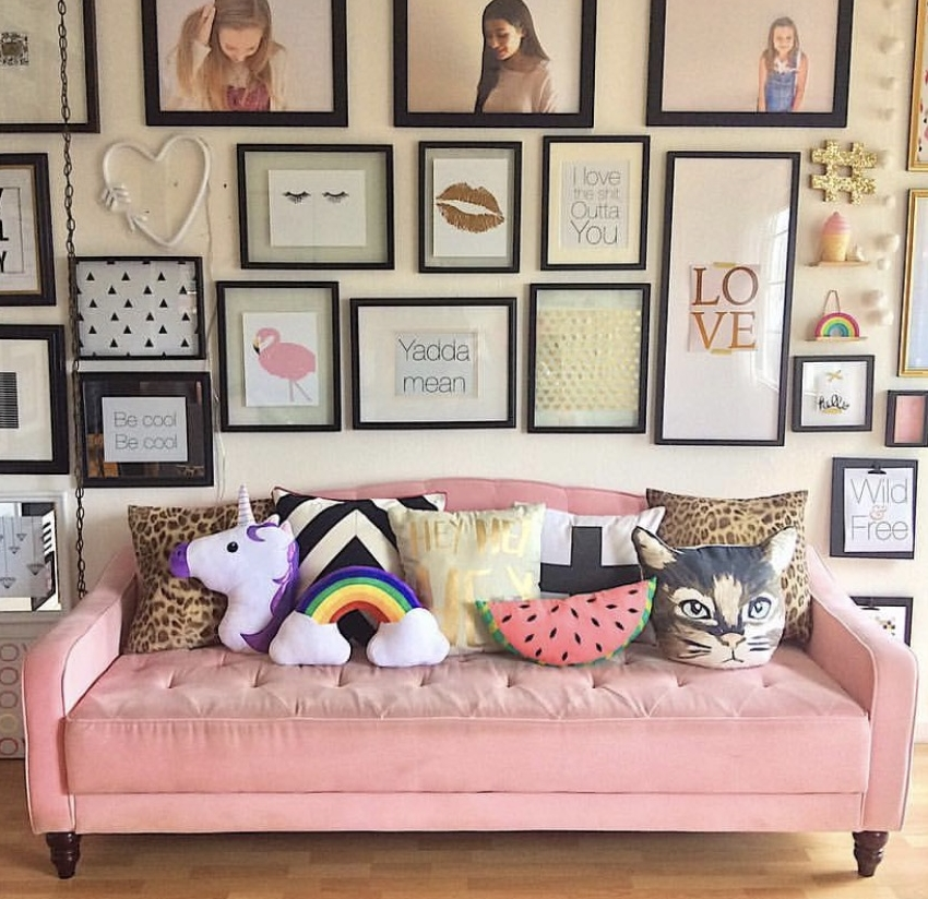 Tamara Lee  has made her pale pink sofa the focal point for her huge gallery wall.