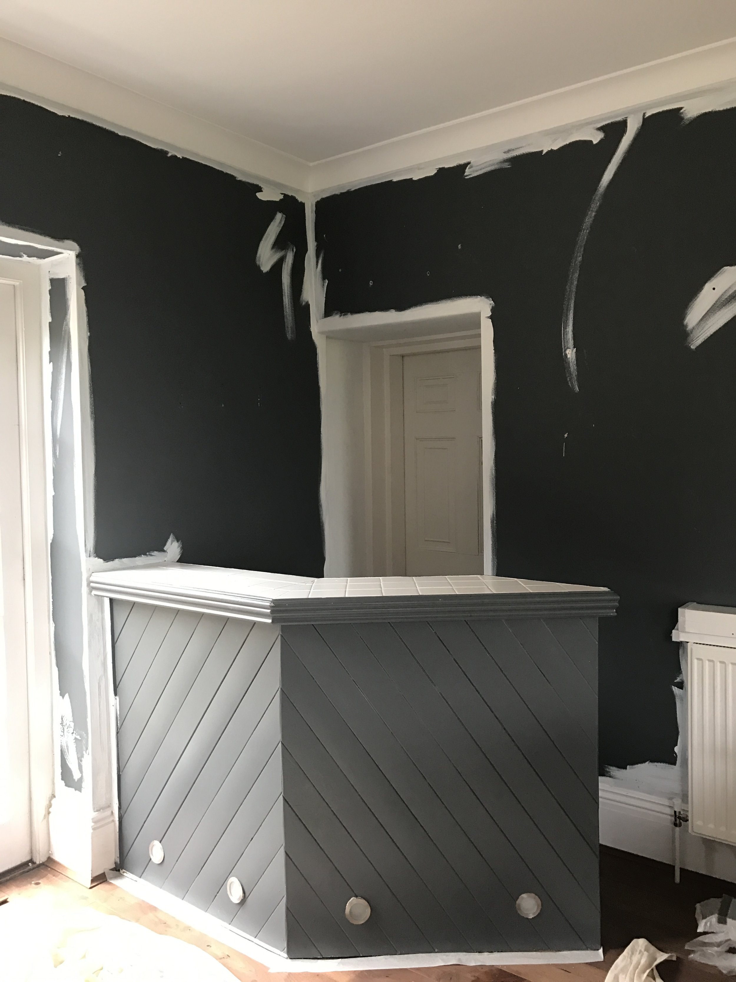 The before shot. Do a quick white paint edge to your walls top and bottom before you start if you have a dark wall.