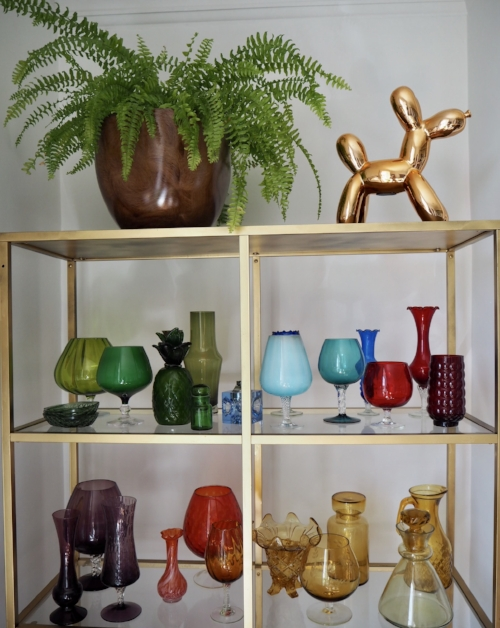 A healthy fern. And my small but gradually increasing coloured glass collection.