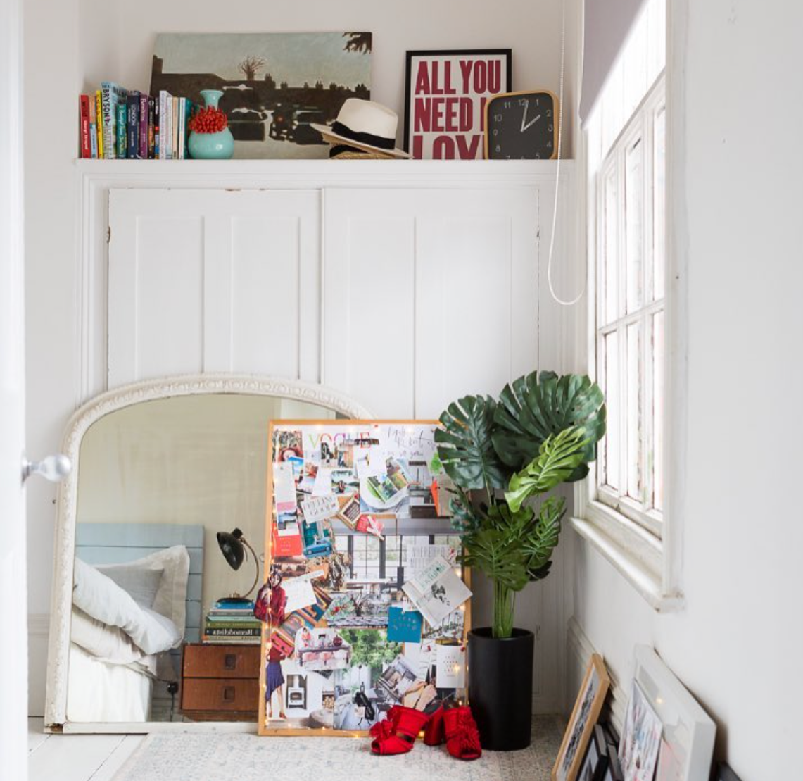 Ciara Elliott  proving that a focal point doesn't need to be an obvious one. Prints, greenery, texture and even a hat and shoes adding interest to this corner.