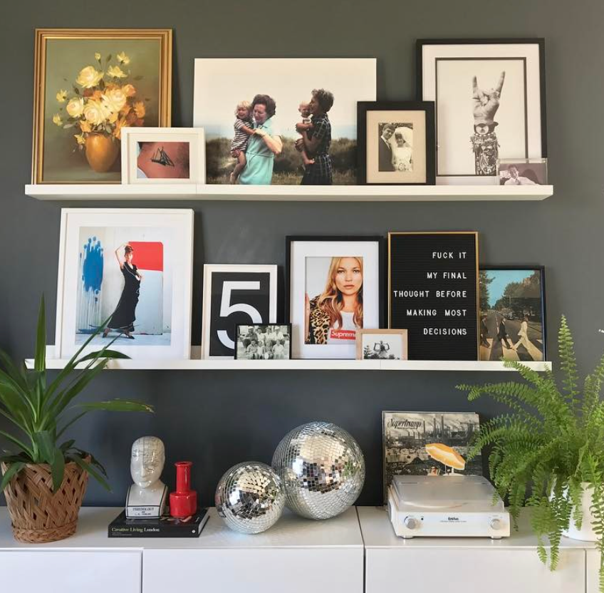My shelves which are lined with vintage finds, album covers, old invites and photographs.