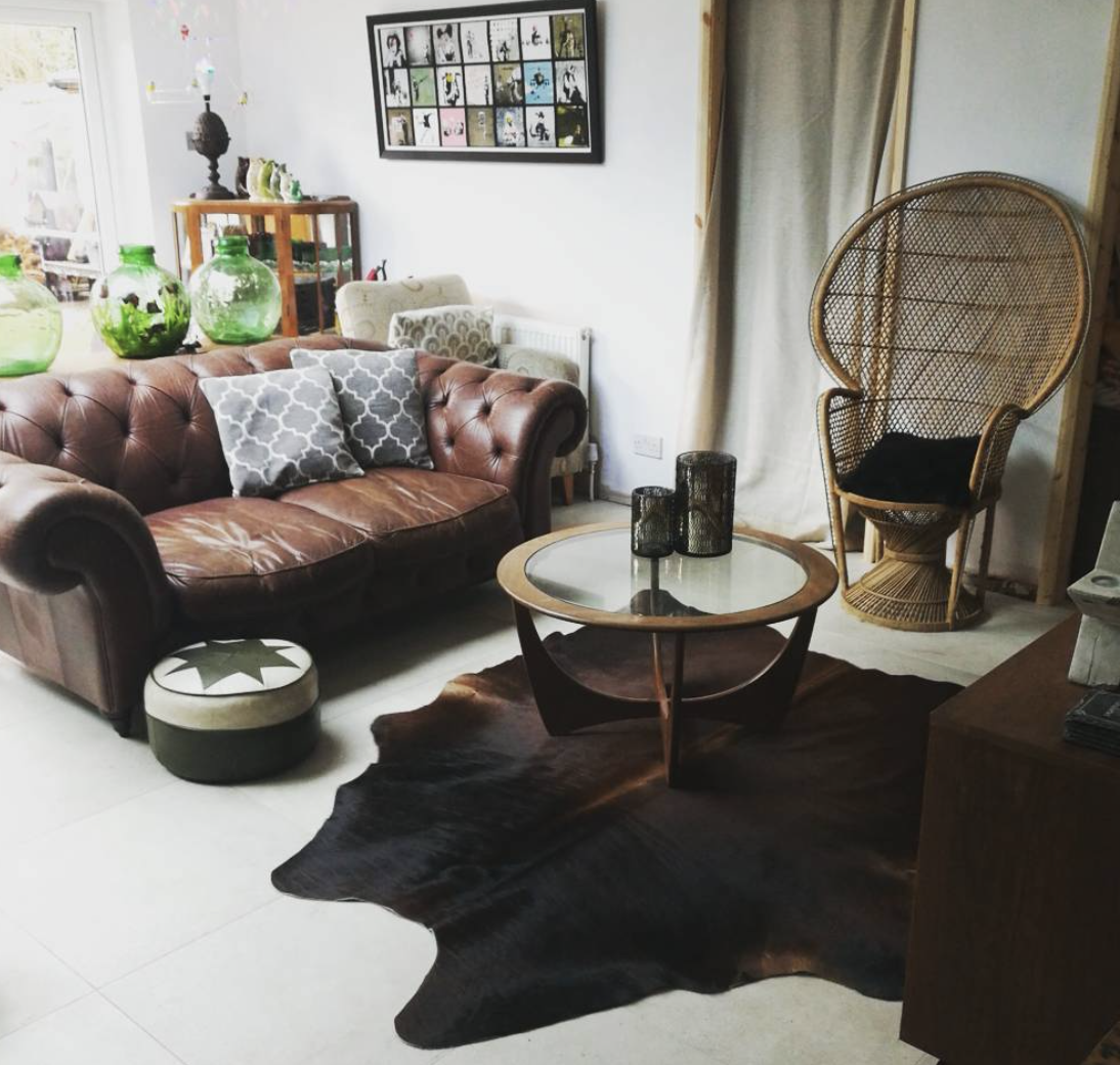 Karen Watson 's living room is nearly all charity and thrift purchases, including the three carboys at the back.