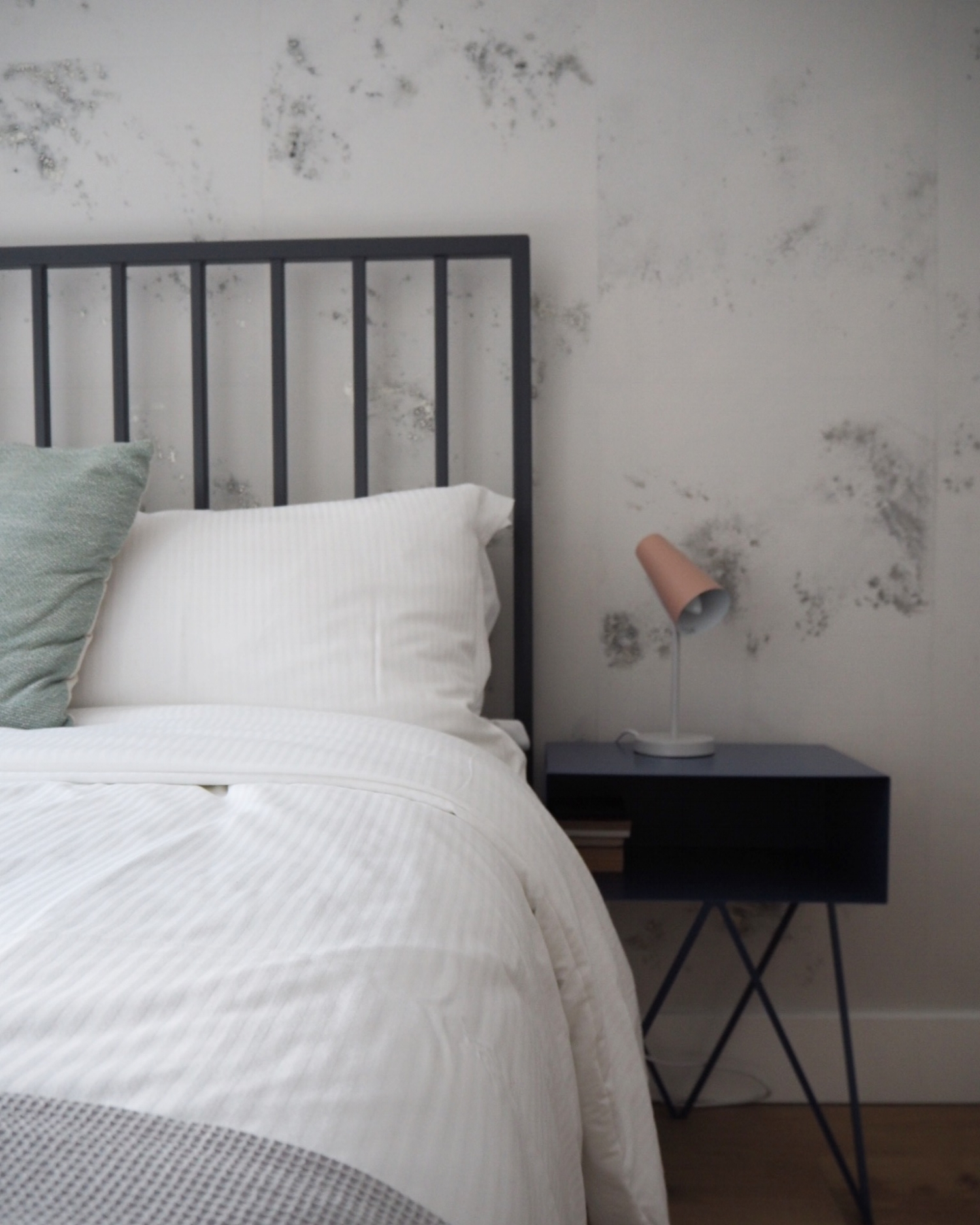 Beautifully styled bedroom with luxury bed linen.