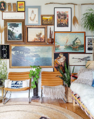 This gallery wall at the home of  Liz Kamarul  has many elements including a wall hanging and even a pair of sandals. Inspirational.