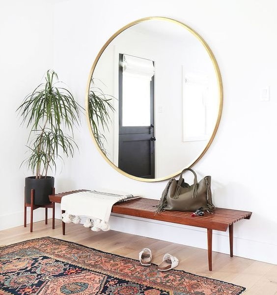 The perfect lobby mirror.  Photo and design credit:   Amber Interiors