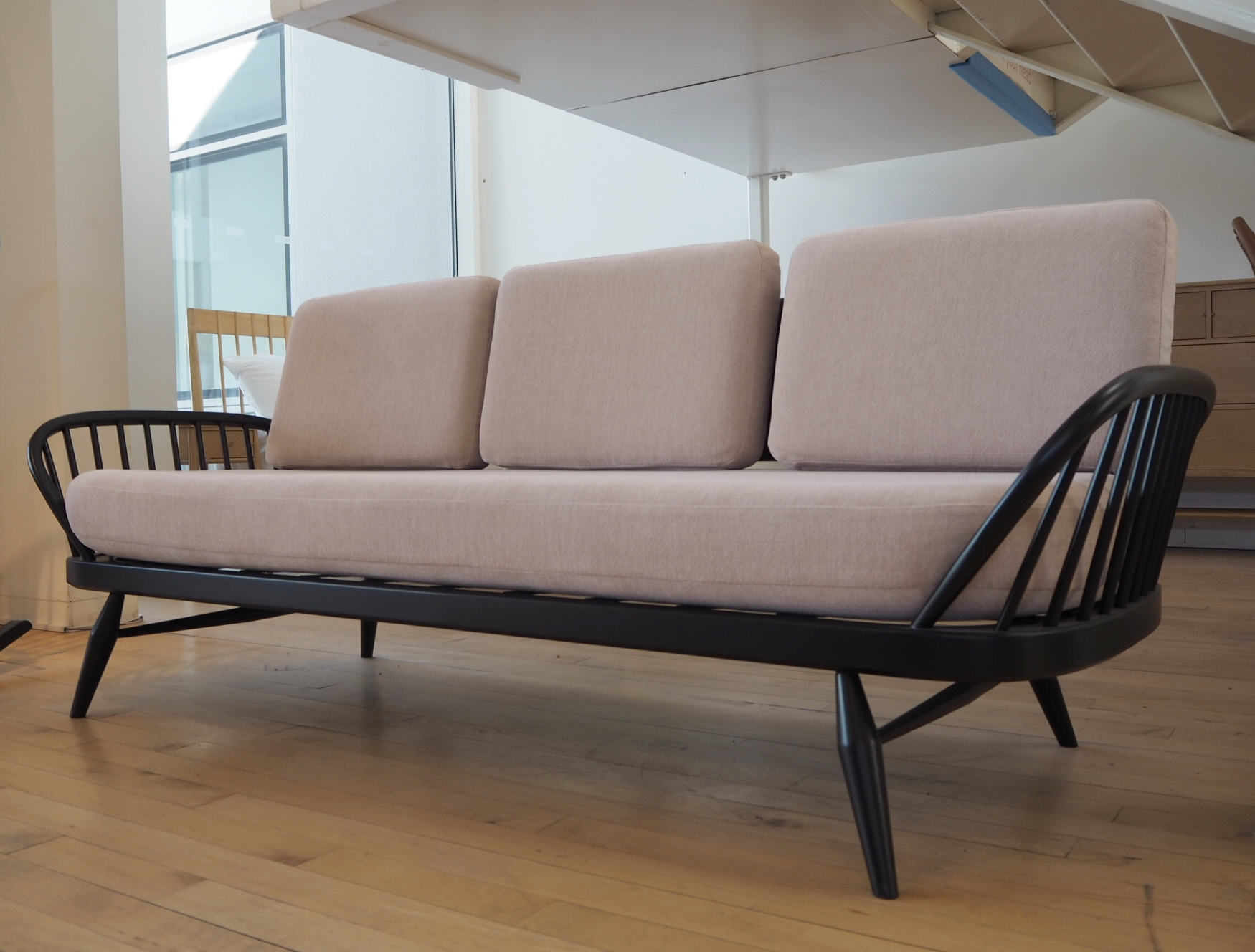 The Originals studio couch, one of many iconic designs seen at the showroom.