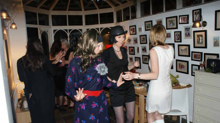 My family gallery wall (mid party). Yes, I am dressed as Margot from The Good Life. Allegedly.