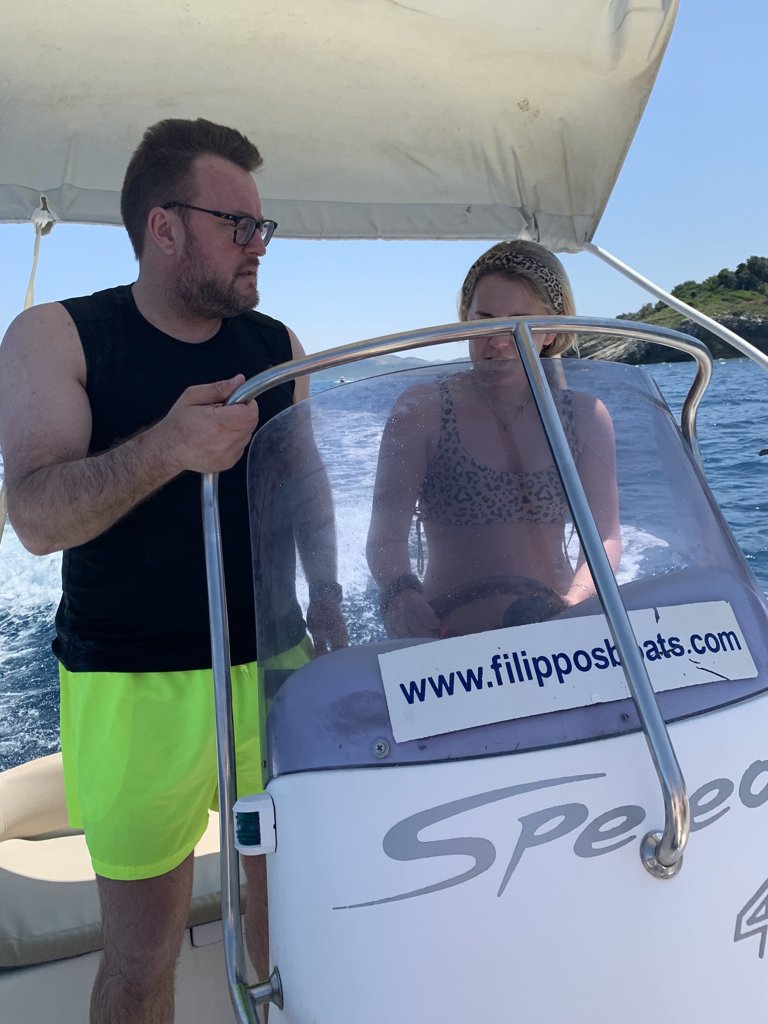 Joe and Ella manning the boat.