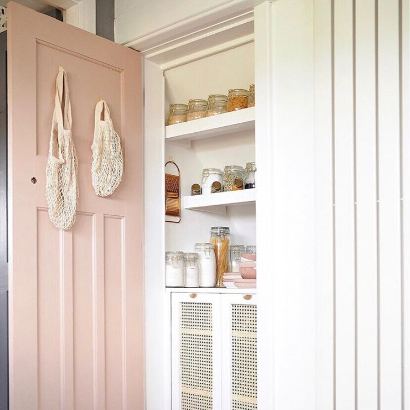 Painting a door is the perfect colour pop in a neutral kitchen: Kitchen,  Olivia Silk .