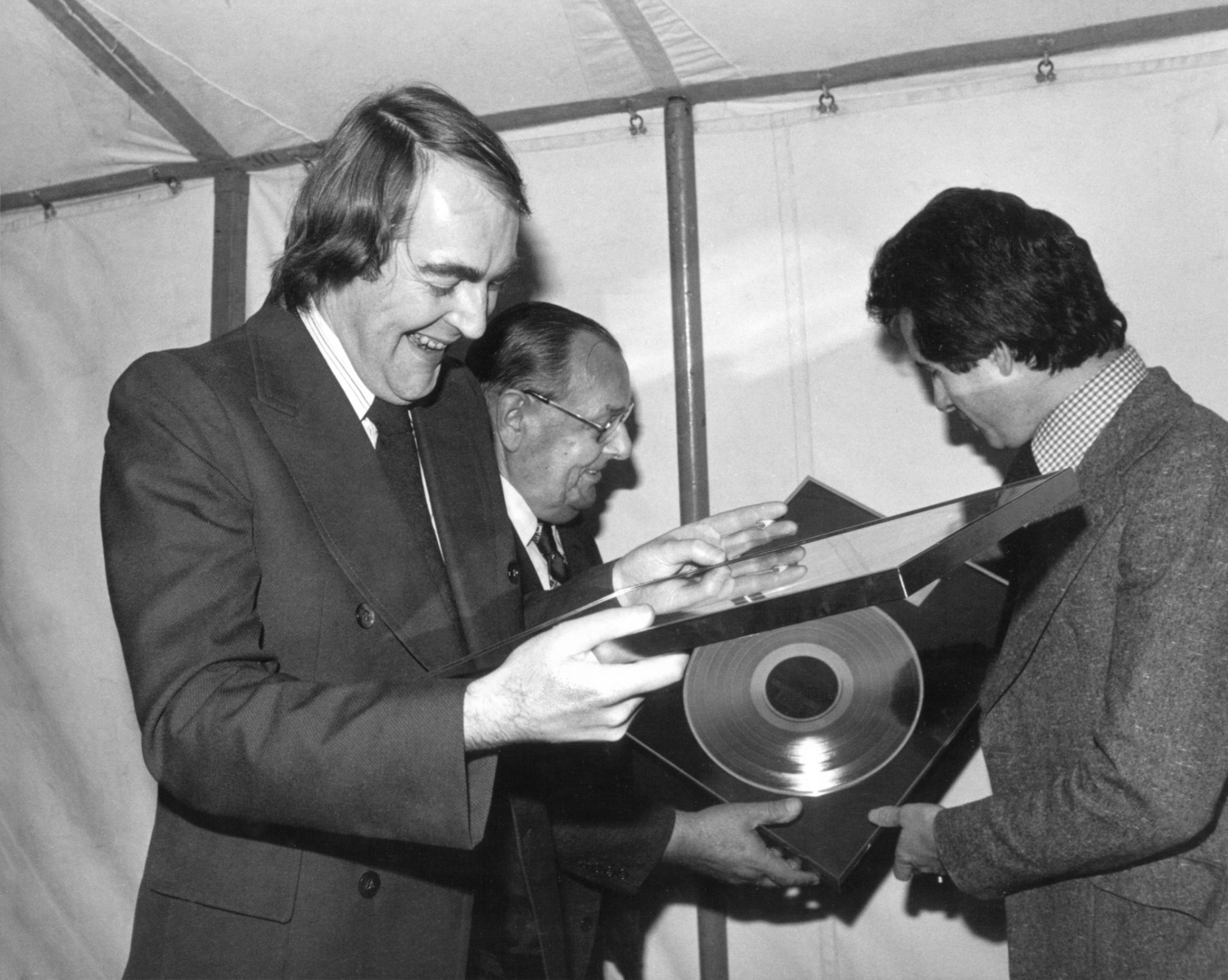 Kevin receiving a gold disc for ten years of work with The Yetties. Bob Arnold (aka Tom Forrest of The Archers) is in the background
