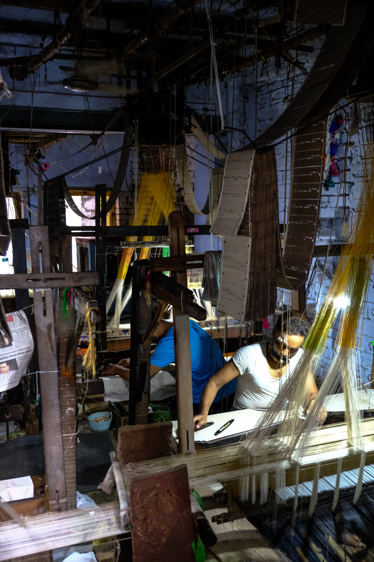 Punch-hole cards hanging over the loom