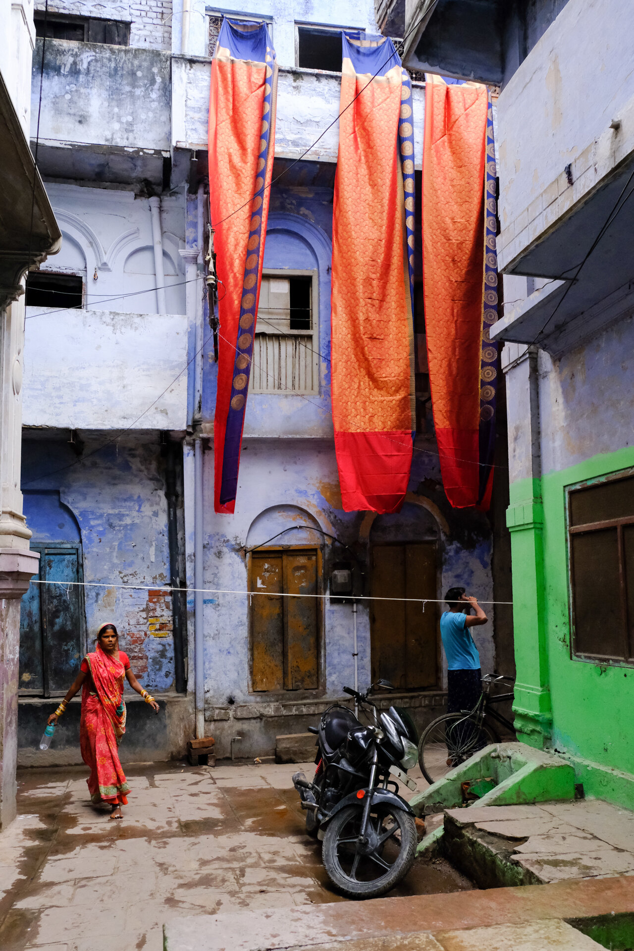 The finished silk saris' hang out to dry.