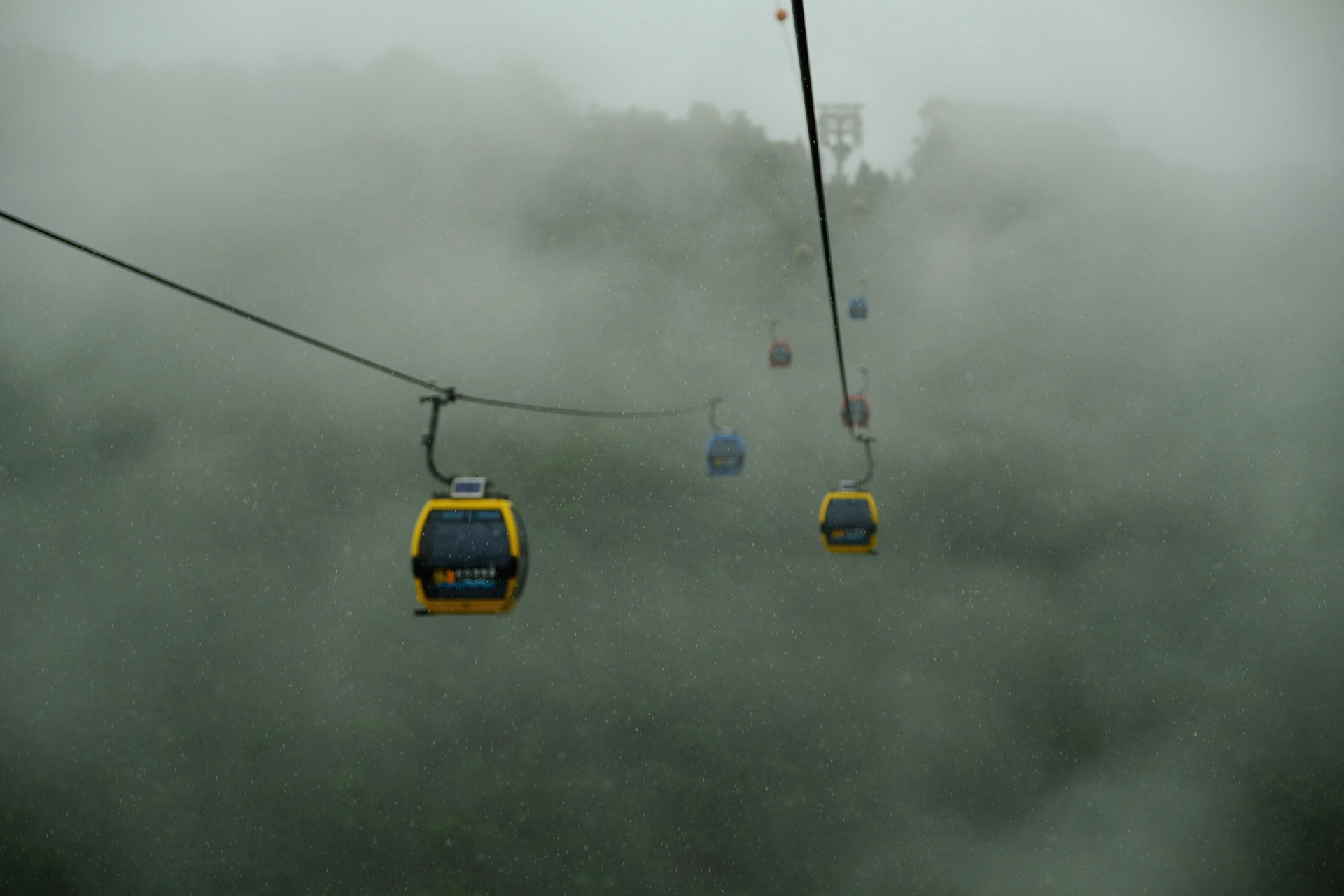 Drifting through the clouds on the rope way.