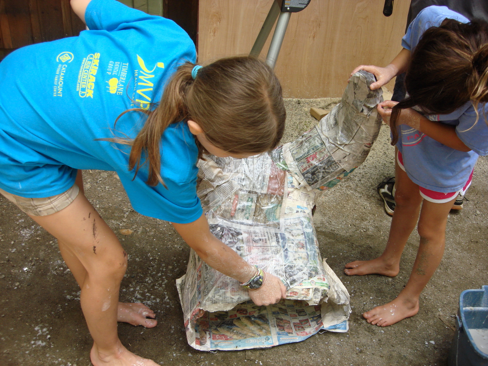 Applying second layer of paper mache