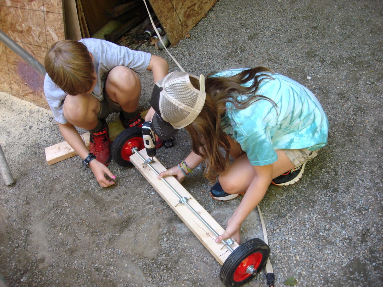 Mia and Frankie making wheel set