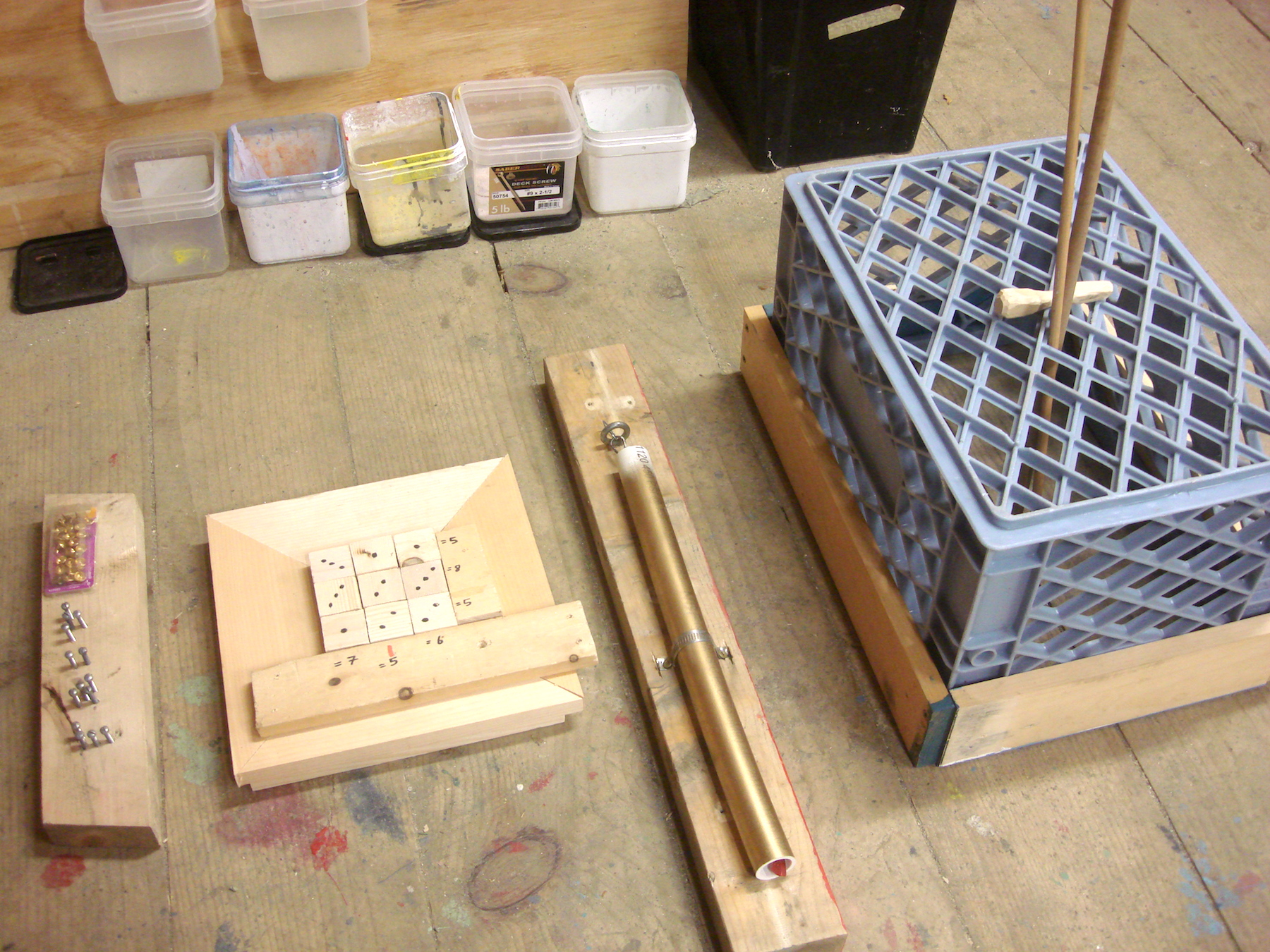 First session accomplishments: sudoku puzzle, crate with dowel chopstick game, and a PVC pipe mount to hide a key.
