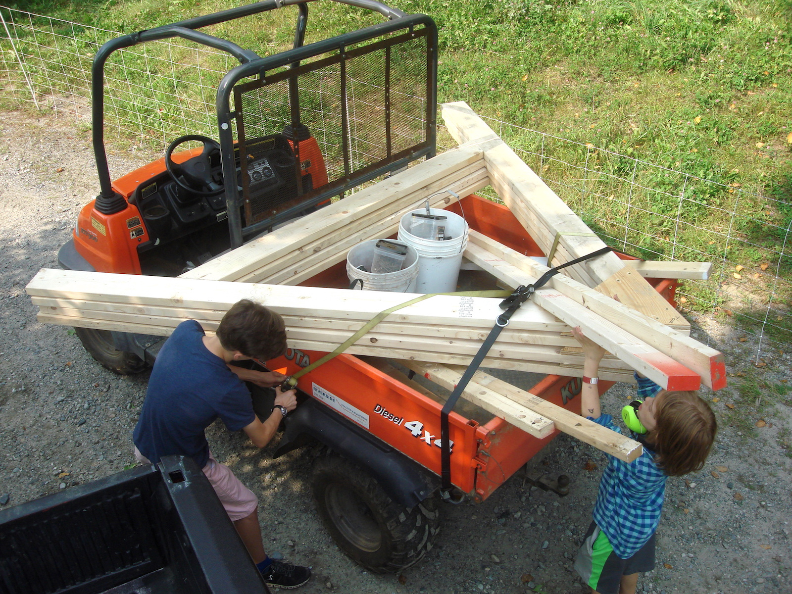 Hale and Ripley ensure that all of our materials are strapped down and secure before driving up to the worksite.
