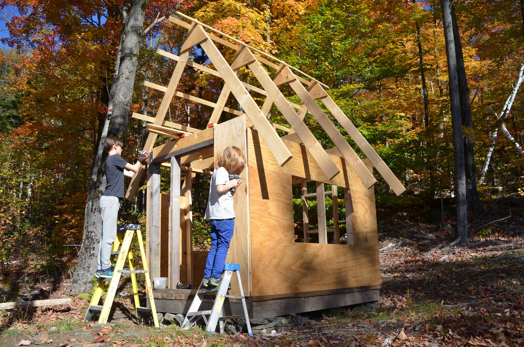 """The brothers screw 1/2"""" plywood sheets onto the frame of their shack."""