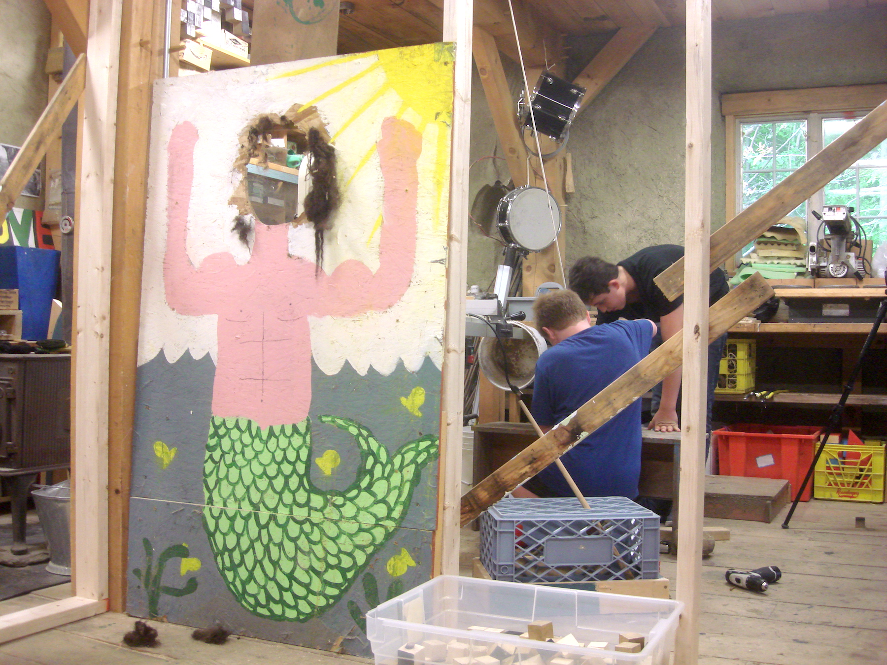 The plywood hanging above the mermaid is suspended by a pulley and counterweight. Noah and Jonas tested a few different items to get the weight just heavy enough.