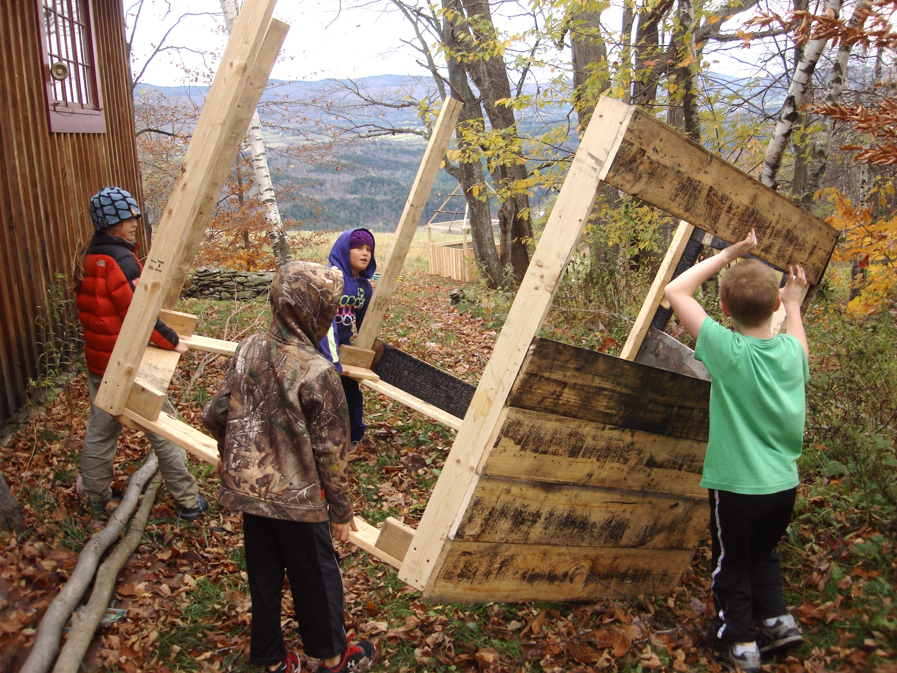 Wren, Will, Annie and Noah drag the hexagon structure out of the shop.