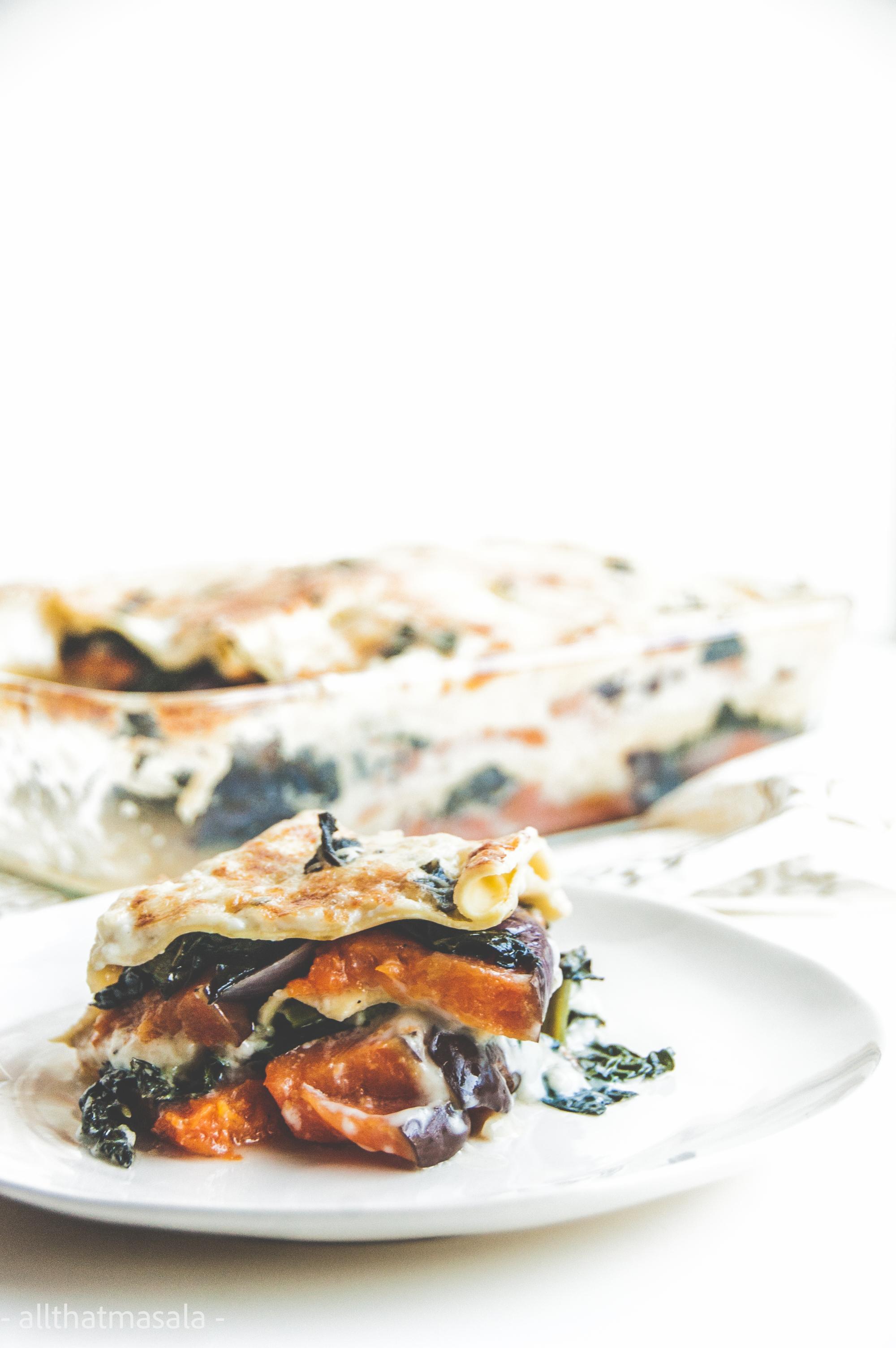 Pumpkin kale lasagna makes a warm pot of autumn dinner delight. This vegetarian lasagna recipe is made with baked cinderella pumpkin, stir fried kale, and warm gooey bechamel sauce.
