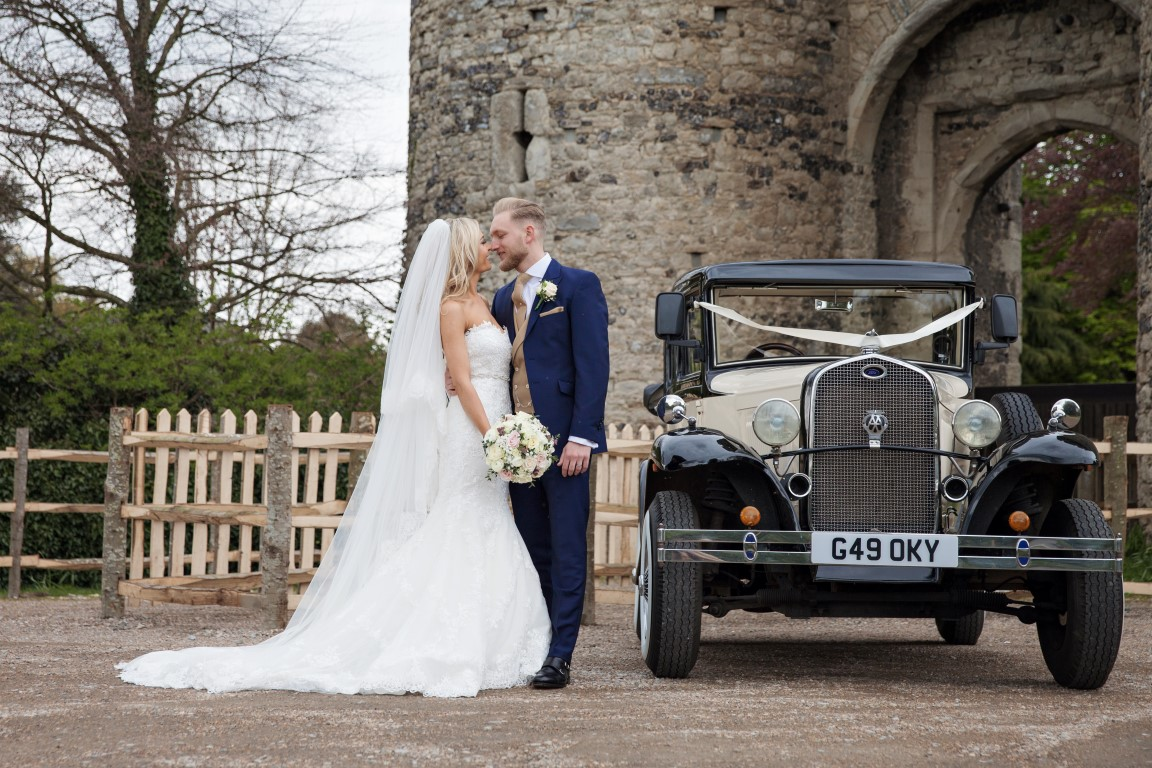 vintage car with bride and groom