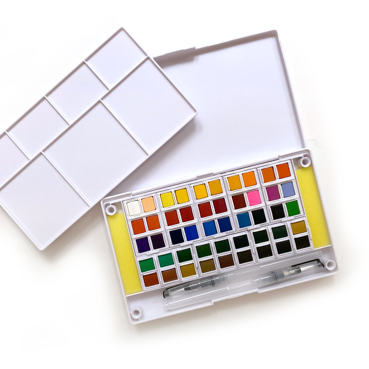 Artify Watercolor Field Sketch Set:  I researched a couple of options and picked this kit because it fit the bill for what I wanted for my trip. It has lots of colors, isn't too big, had a removable palette for blending, and room for water brushed to fit inside along with sponges. (Plus, this price was right for someone who doesn't know what they're doing!)