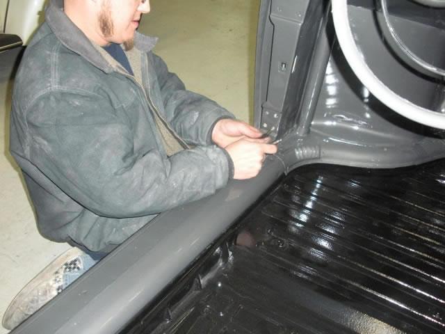 289 Tapping doors screw holes_jpg.jpg