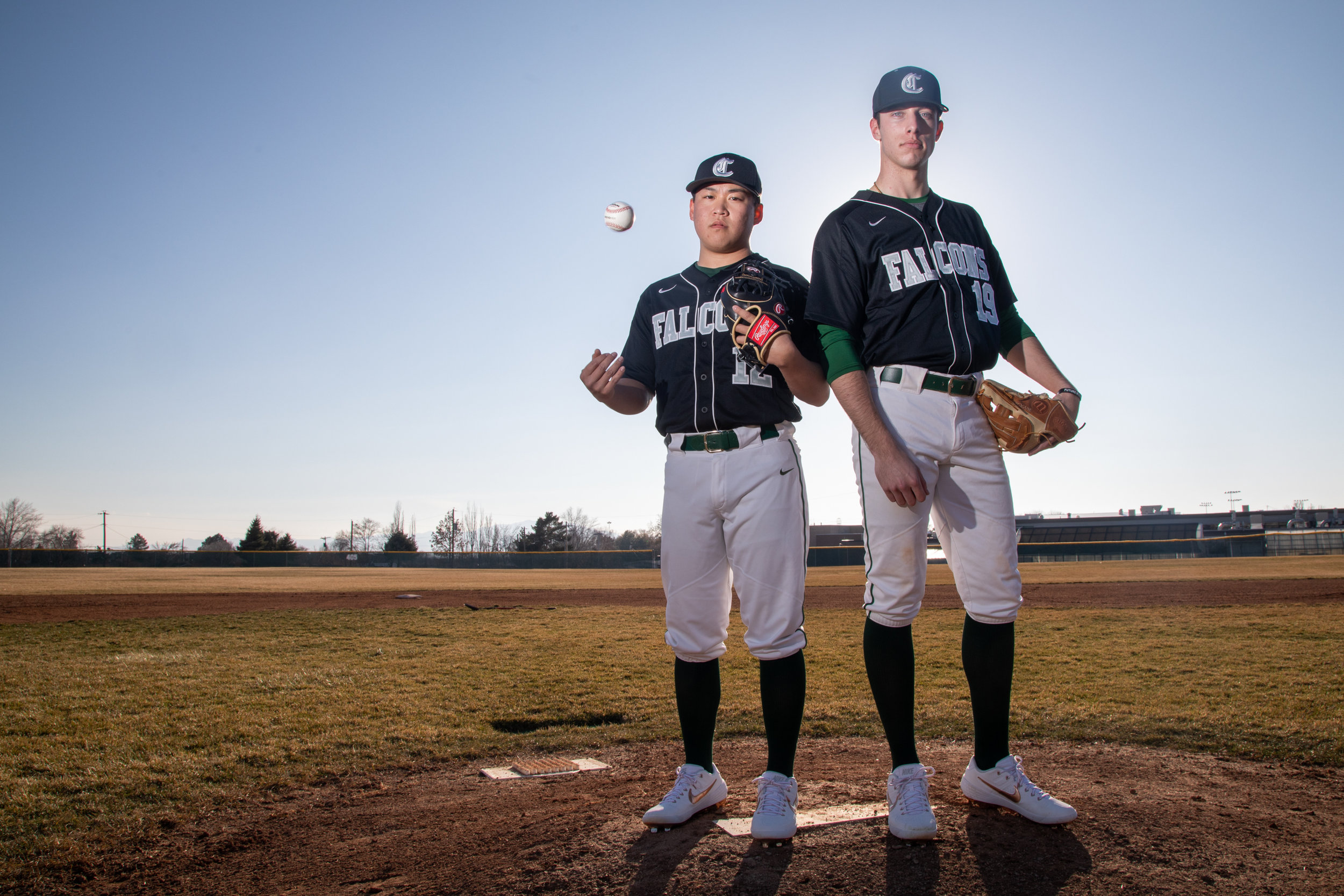 Clearfield High pitchers, Bryson Hirabayashi, left, and Conner Coleman pose on the mound at the high school on Monday, March 11, 2019.