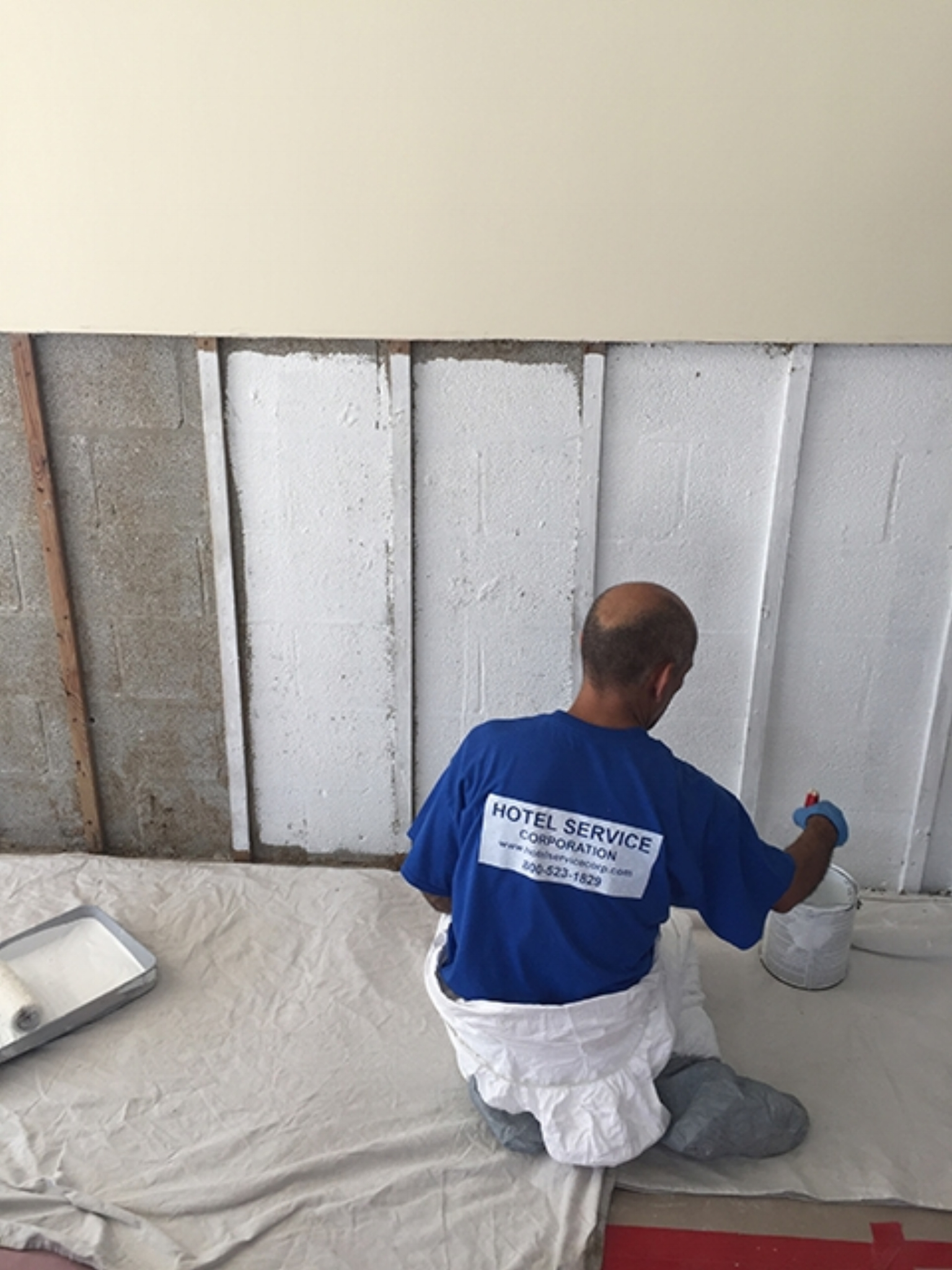Applying fosters 40/20 encapsulation on a wall prior to replacement of drywall