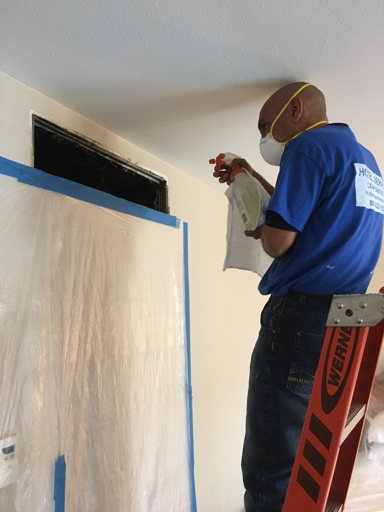 Applying antimicrobial agent into a guest room air duct