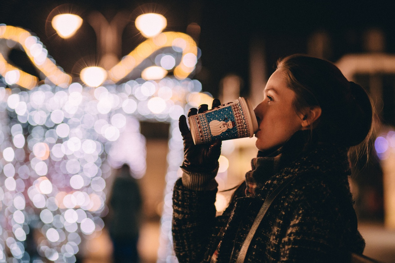 woman drinking coffee in the snow | Northwest PA Doulas