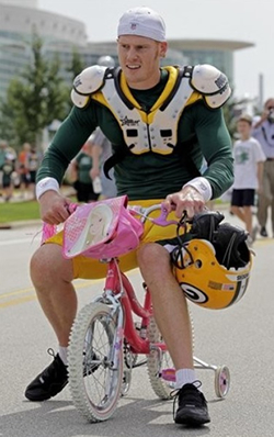 The Ginger Wolverine is man enough to ride a tiny pink bike.
