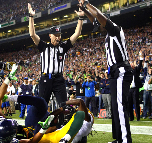 After a ten minute review, the replacement referees ruled Tate caught the ball for a game-winning touchdown.