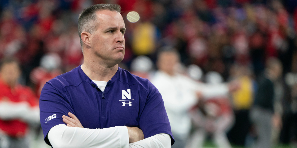 Fresh off a bowl win, Northwestern's Pat Fitzgerald renewed his commitment to his alma mater. The Pakcers, however, are still interested.