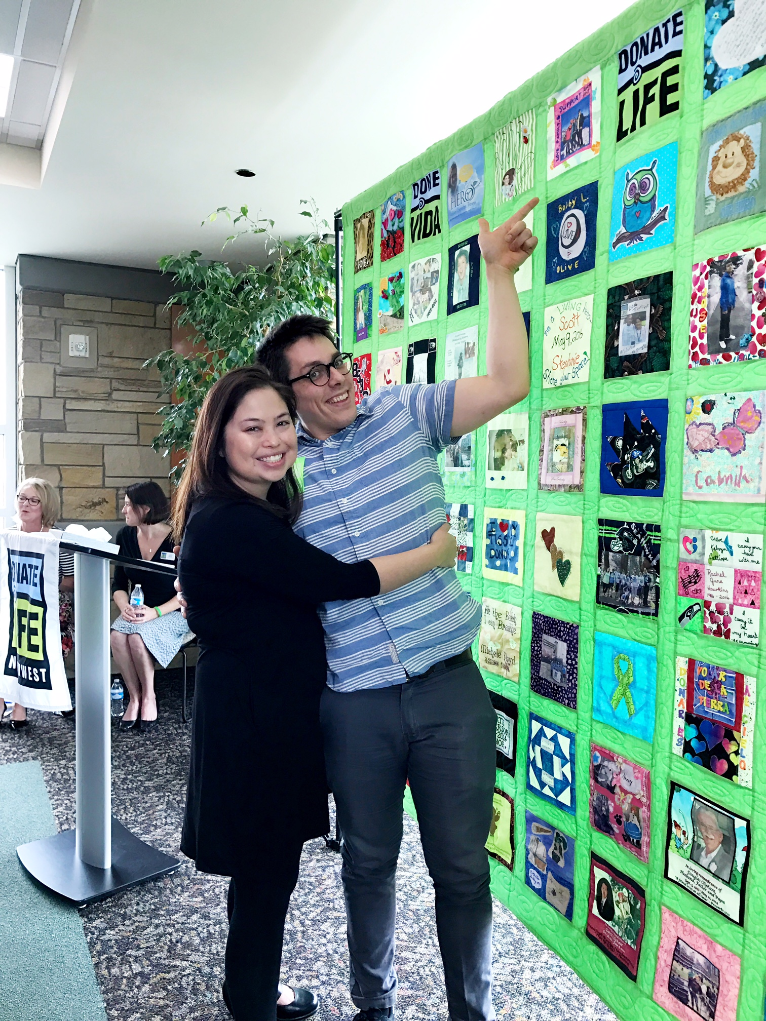 Joshua and I pointing to our square piece at the Donate Life NW quilt unveiling.