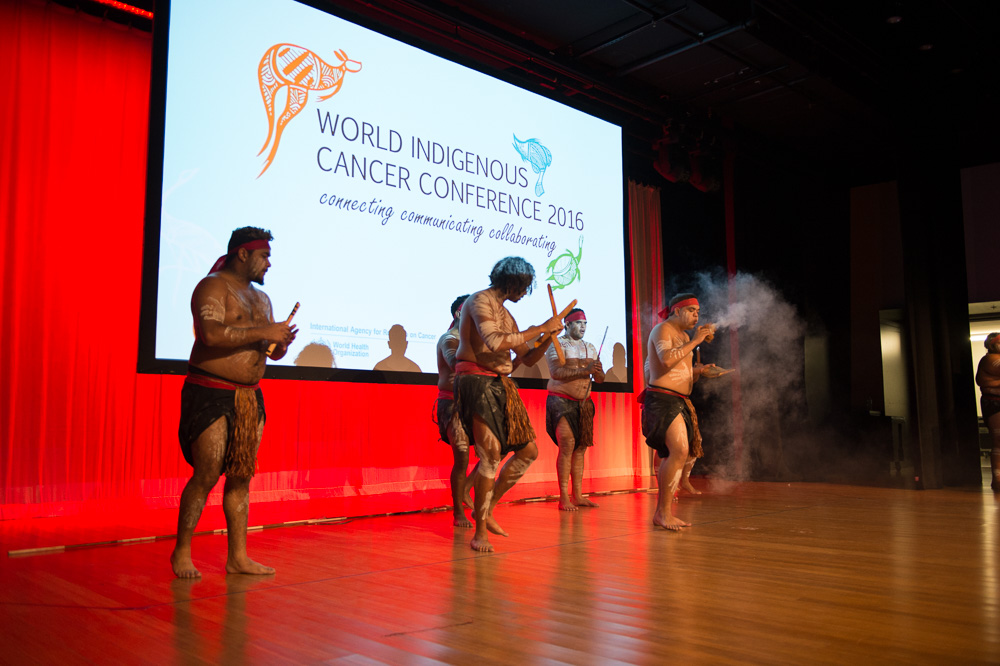 Nunukul Yuggera perform a smoking ceremony during the opening ceremony