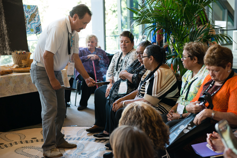 Jerome Yellowdirt performs a Smudging Ceremony prior to presentation in the Yarning Circle