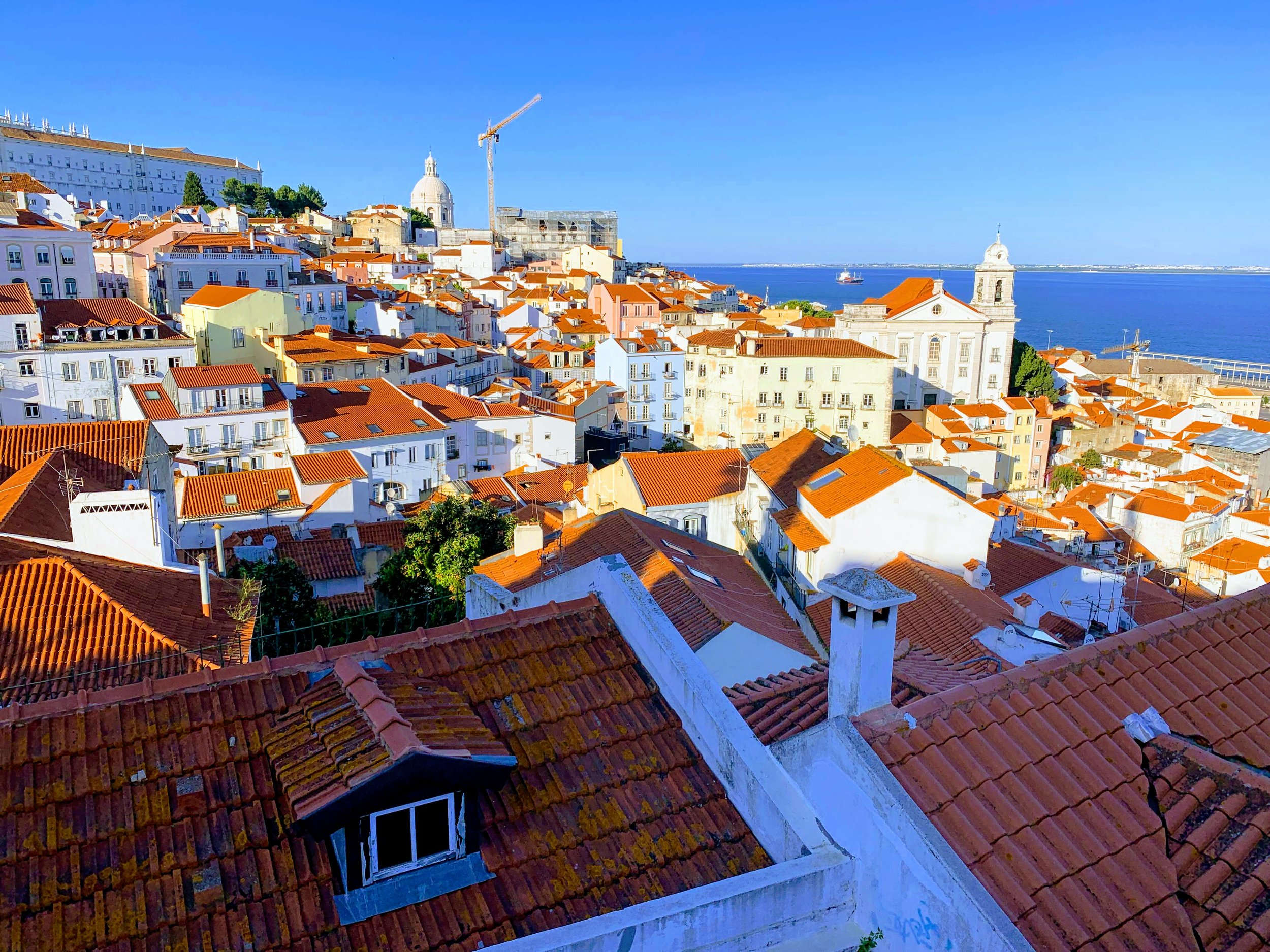 Lisbon - red-roofed homes by the sea