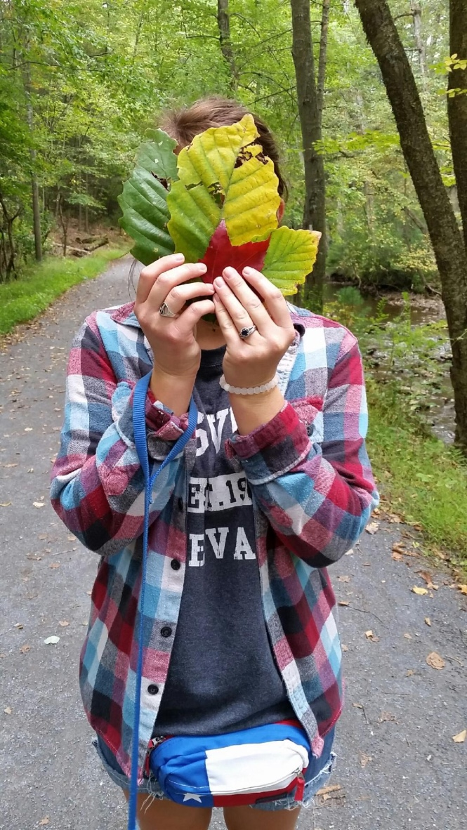 Leaf collecting on the trail. Yes I wear a fanny pack! (: