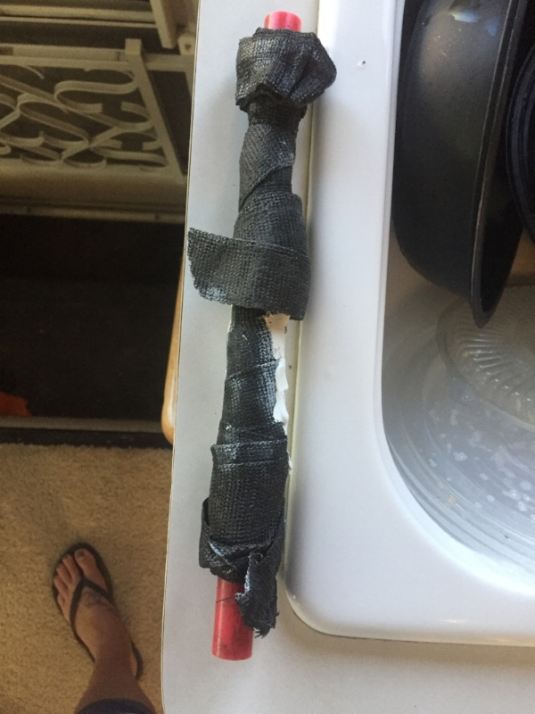 """Our """"temporary fixes"""" that didn't work! HAHA! I actually think it would've worked if we had been able to actual access the pipe and wrap this correctly."""