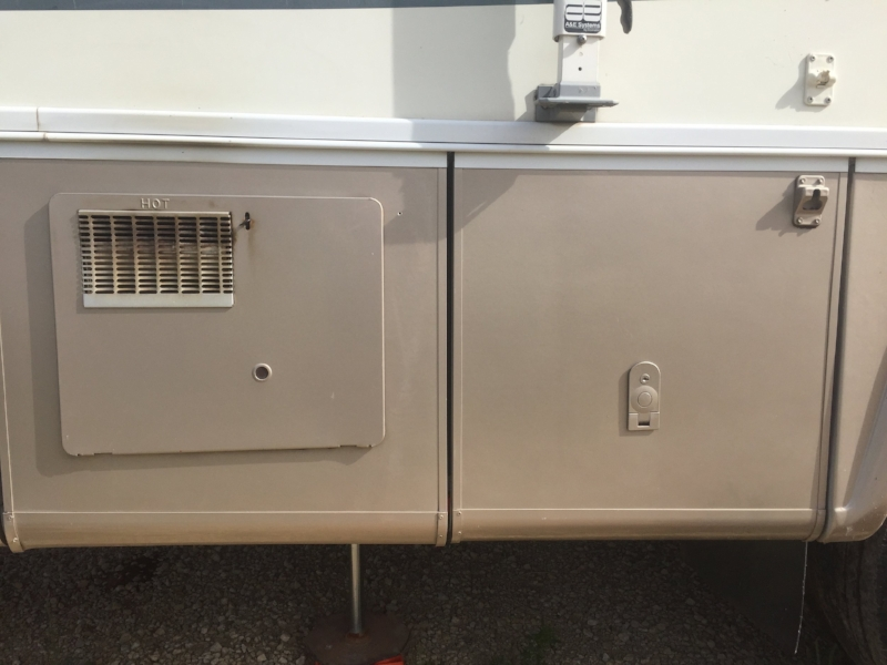 Access panel on the left. The storage door on the right is where we found the above valves we needed to turn on.