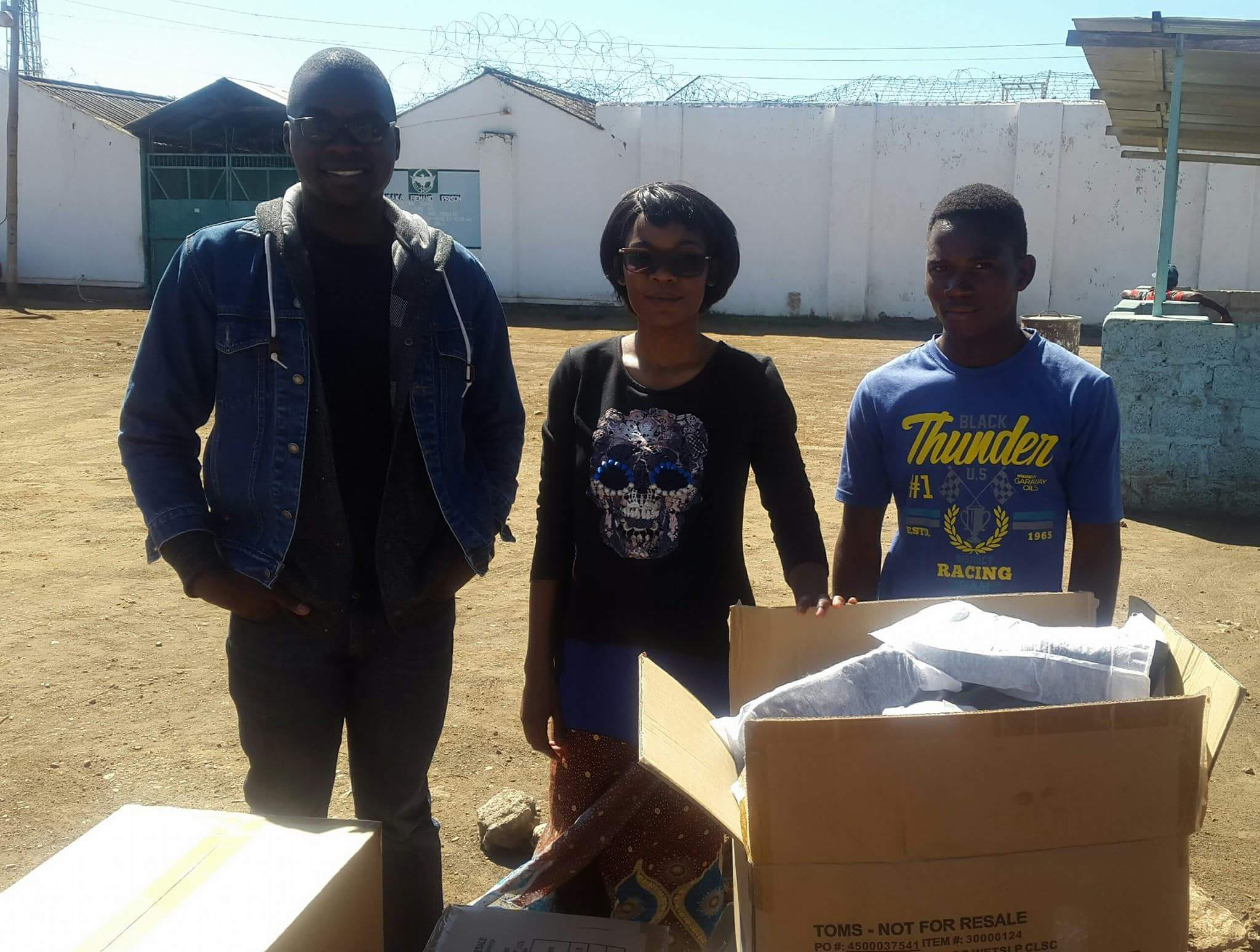 Faith and UP Zambia volunteers during a prison visit to distribute donations for incarcerated juveniles.