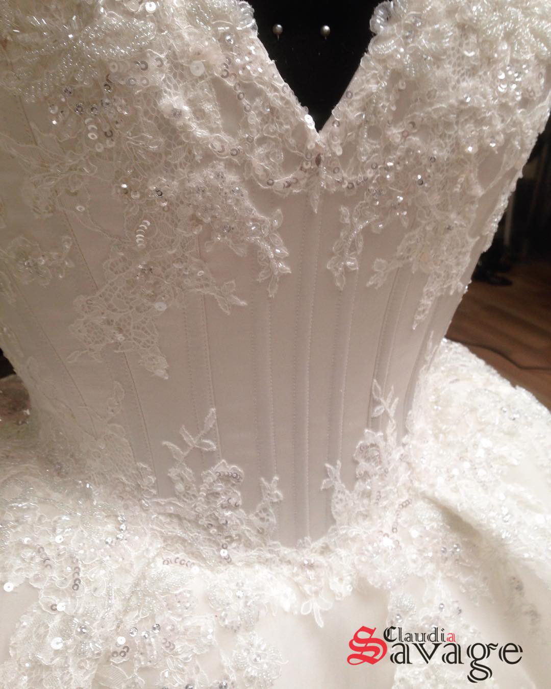 Layered lace details that covered the corset bodice and gown.