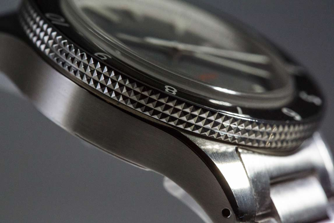 The knurled bezel grip is not visible when looking straight-on at the watch. The case has a slight bowl shape to it, which helps take some heft away from the watch.
